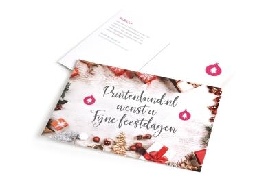 Kerstkaart met logo bij kerstkaarten drukkerij