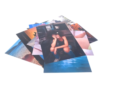 Print glossy photos, always pick them up quickly or have them delivered